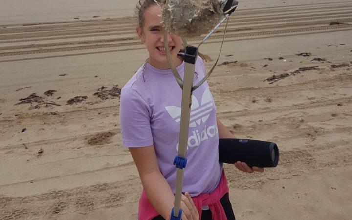 Carinity student cleaning up Yeppoon Beach