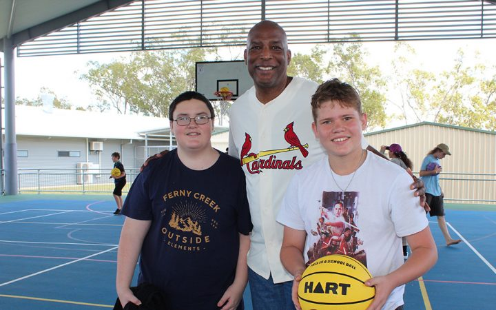 Carinity Education Rockhampton students Alex Fisher and Johnathan Stevens with Eric Bailey