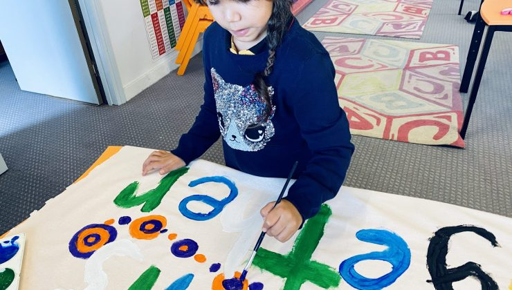 Shalom Student painting for Reconciliation Week